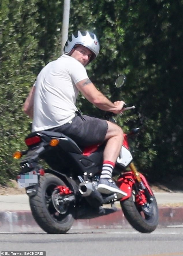 Vroom vroom! Dax cut a casual figure in a T-shirt and shorts as he ran errands in the Californian sunshine