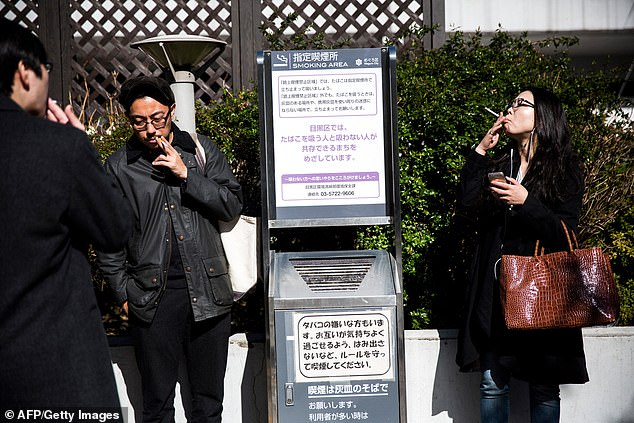 Nomura, the country's biggest investment bank, has asked its local staff to give up smoking during the working day in a move labelled as 'intrusive' [Stock image]