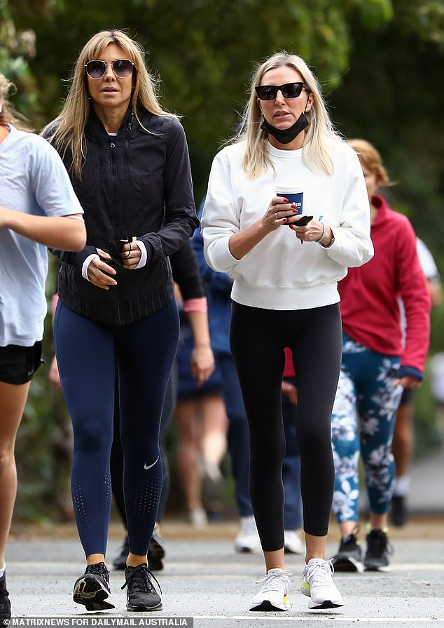 Walk:Tania Buckley (née Minnici) headed out for a leisurely stroll at Melbourne's Royal Botanical Gardens on Saturday. Pictured with a friend