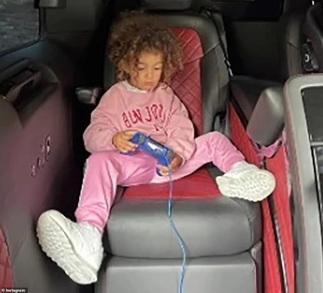 One of Ronaldo's children is pictured playing a game while travelling to the UK with the family from Faro airport