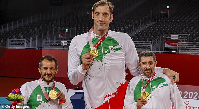Morteza Mehrzad (centre) helped inspire Iran to gold in the sitting volleyball on Saturday