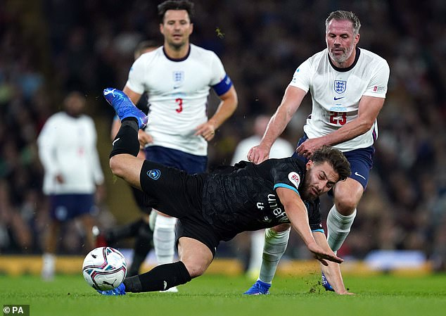 Jamie Carragher (right) was criticised by fans online after seeming to kick out at former Love Island star Kem Cetinay (bottom) during the Soccer Aid charity match on Saturday evening