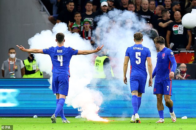 A smoke flare is pelted at England's players as they celebrated one of their four goals