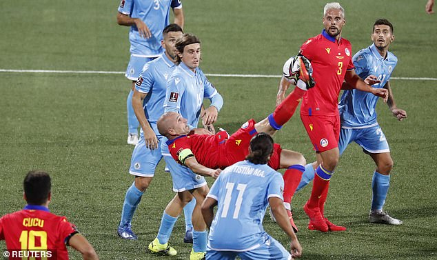 Andorra captainMarc Pujol attempts an overhead kick during their win over San Marino