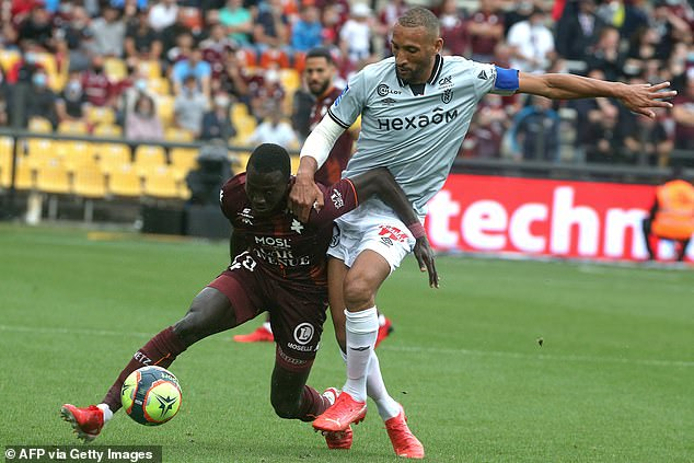 Lamine Gueye (left), who trained at Generation Foot alongside Sarr, has said he is not surprised to see his former team-mate's success - claiming he works 'hard' and is 'very serious'
