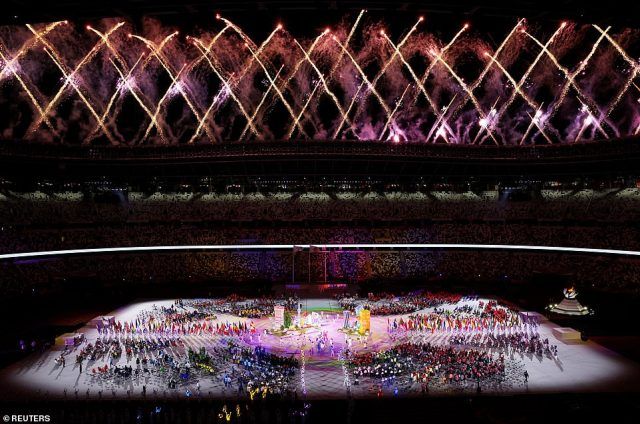 Images were beamed onto the floor of the stadium while performers danced and waved to the cameras