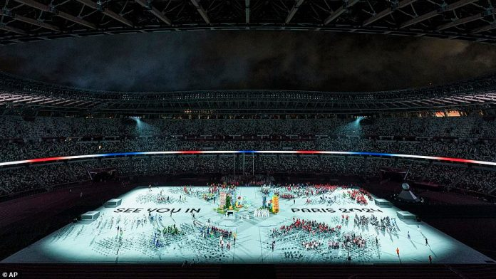 A final projection beamed onto the floor telling viewers that they will see them in Paris for the Olympics in 2024