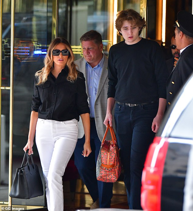 Melania returned to Mar-a-Lago last month, where she will reside full time as Barron Trump, 15, (right) attends private school. The two are pictured leaving Trump Tower in Manhattan on July 7, 2021