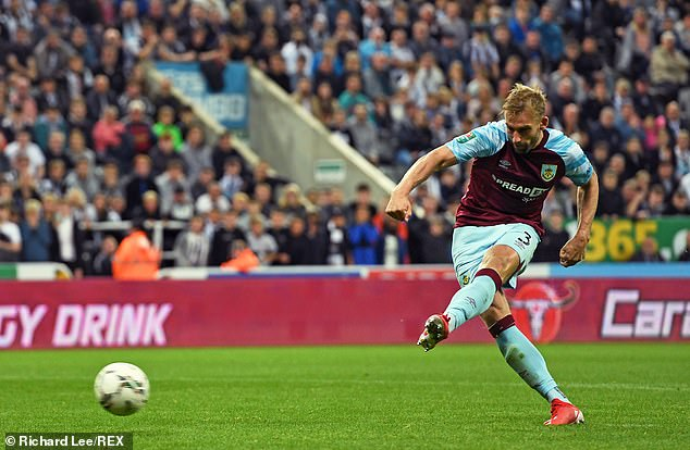 A Newcastle fan reacted to Burnley's Charlie Taylor accidentally hitting him with a stray shot