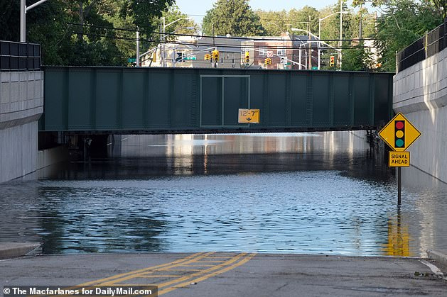 Severe flooding is seen in Queens on Thursday morning. Of the 13 people killed in New York City, 11 were found dead in basements