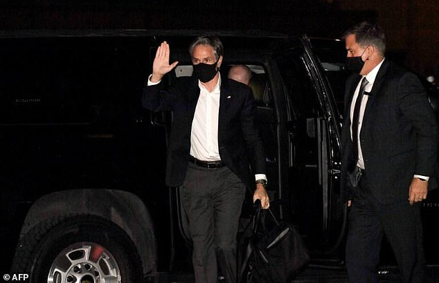 US Secretary of State Antony Blinken waves as he gets ready to board an aircraft from Joint Base Andrews in Maryland to travel to Doha on Sunday evening for Afghan talks