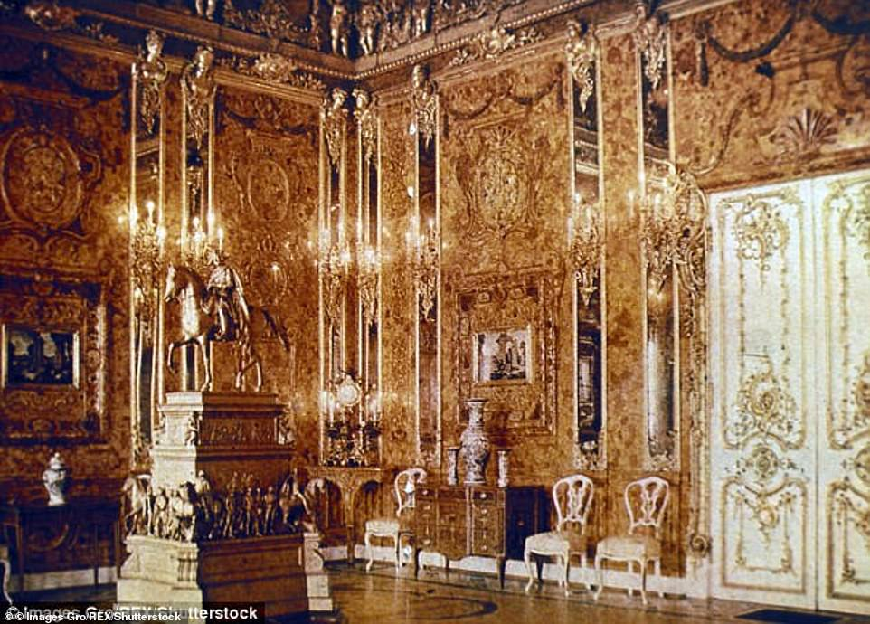 The Amber Room (pictured in Russia in 1917), which was packed with amber, gold and precious jewels, was looted by the Nazis in 1941 and its contents mysteriously disappeared with the collapse of Hitler's regime in 1945