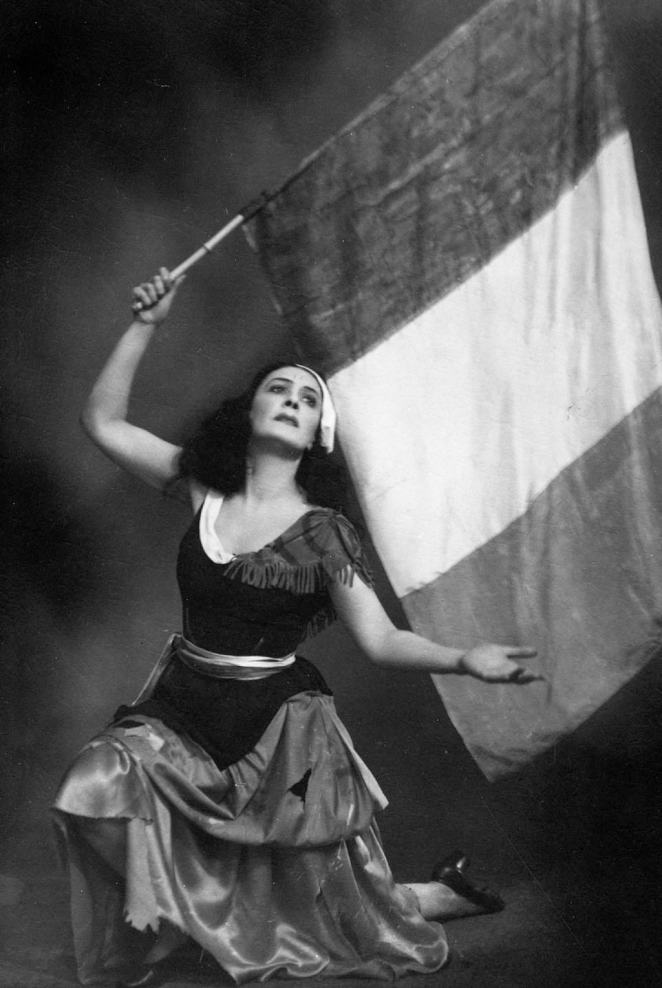 At Karlag, Nina survived in part thanks to the fact that she was able to dance in productions put on by ensembles of performers who were imprisoned with her. Above: Nina is seen in the early 1950s performing the Flames of Paris, the In one The image with the French flag is from the early 1950s. It shows Nina in the ballet the Flames of Paris, which depicted the French Revolution. When she was initially arrested in February 1938, Nina had performed the ballet just a month earlier