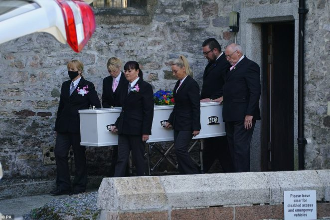 A coffin carrying the bodies of both Sophie Martyn, 3, and her father Lee Martyn, 43, leaves a church in Plymouth today