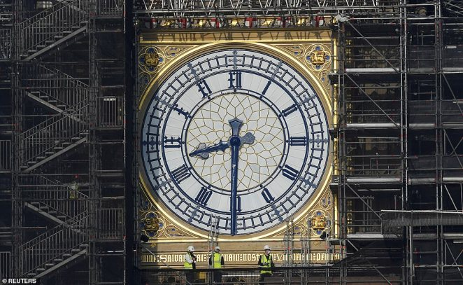 Six of the new St George's flag shields can be seen under the scaffolding on the Elizabeth Tower in Westminster today