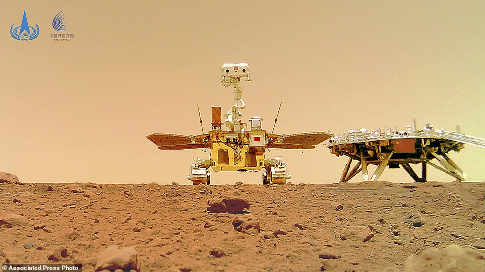 In this image released by the China National Space Administration (CNSA) on Friday, June 11, 2021, the Chinese Mars rover Zhurong is seen near its landing platform taken by a remote camera that was dropped into position by the rover