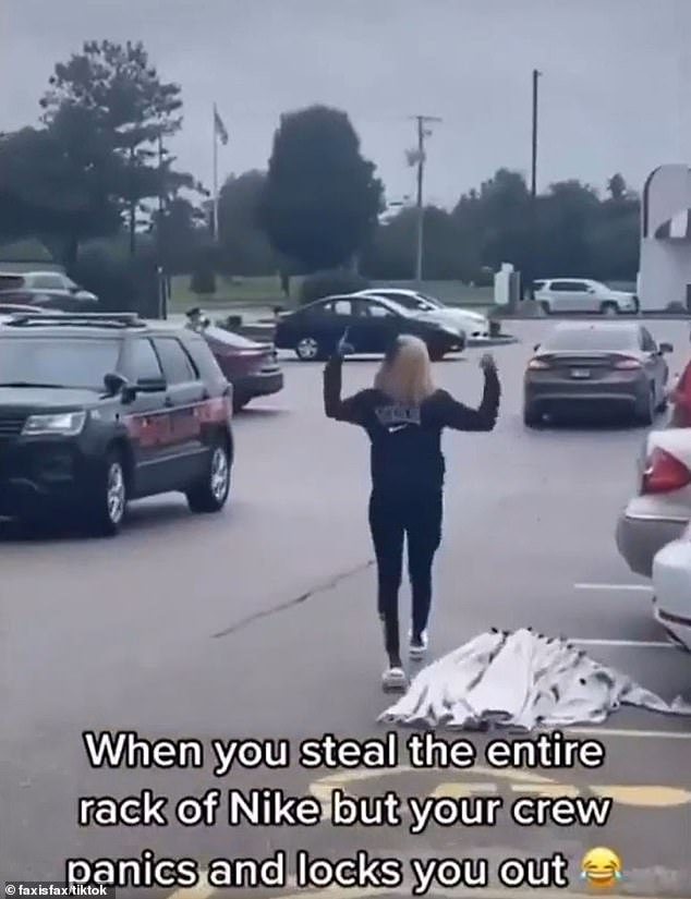 She continues walking after the car, shouting, as a security vehicle pulls up alongside her