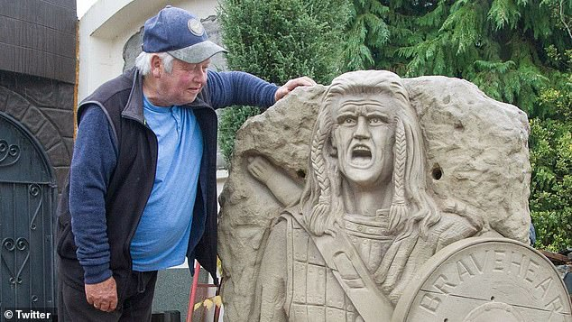 Church, seen here posing with the sculpture he says he's most proud of, has been unable to find his work a permanent home