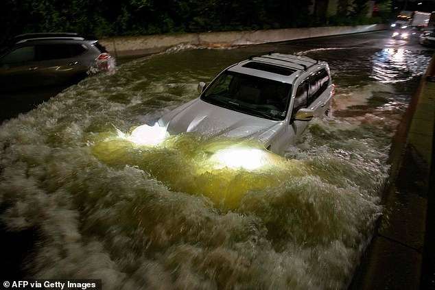 Many of the deaths associated with the storm came from motorists trying to drive through the flooding. One driver is seen here trying to make his way through a flooded expressway in Brooklyn on September 2