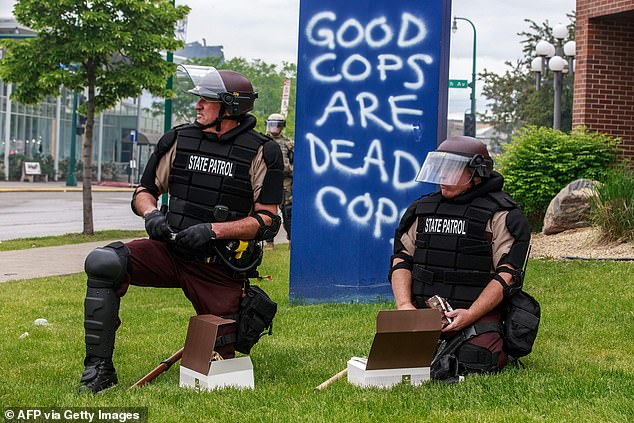 Dwyer said they were not instructed to delete their communications, but claimed it is a standard practice. State Patrol officers are pictured on the fourth day of protests last year