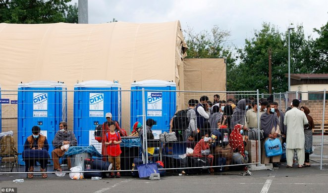 Afghan refugees are seen on August 30, lined up with their belongings and ready for their evacuation flight
