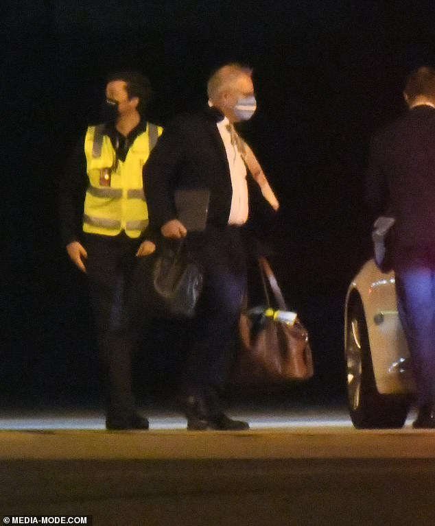 Scott Morrison, pictured here on the tarmac at Sydney Airport, then flew back to Canberra without enduring 14-day hotel quarantine at either end.