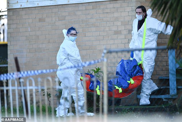 A woman has died with a wound to her lower body in suburban Brisbane, and a man believed to be her 'on-again off-again' partner is being questioned by police (pictured, police at the scene)