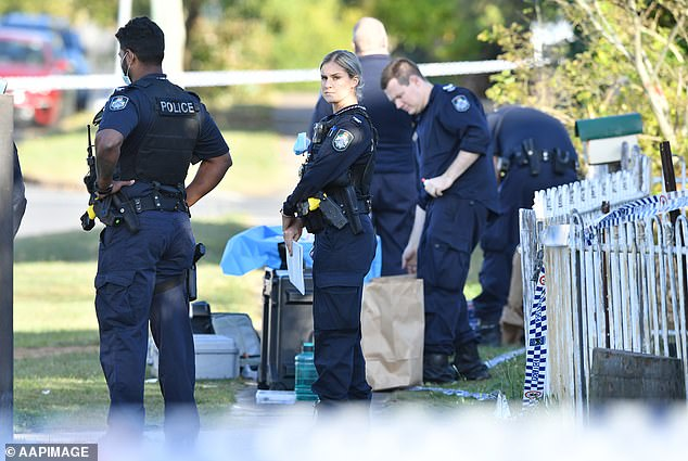 Investigators believe the woman's wound was caused by a weapon but no arrests have been made and the 43-year-old man is assisting police voluntarily (pictured, police at the crime scene)