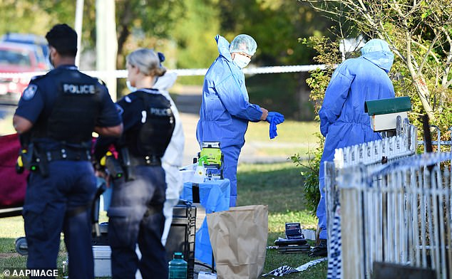 Despite the 'best efforts' of paramedics, the 45-year-old woman died at the scene just under an hour later (pictured, forensic police search the crime scene)