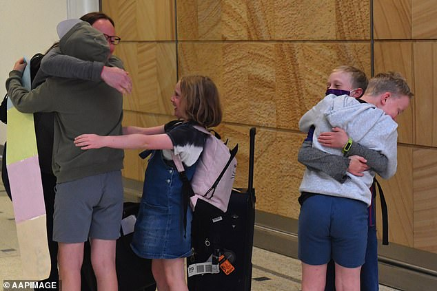 Australia is one track to have 90 per cent of the population fully vaccinated well before Christmas as anti-vaxxer sentiment wanes (pictured is a family at Sydney airport in April when a travel bubble with New Zealand was opened before the Delta variant appeared)