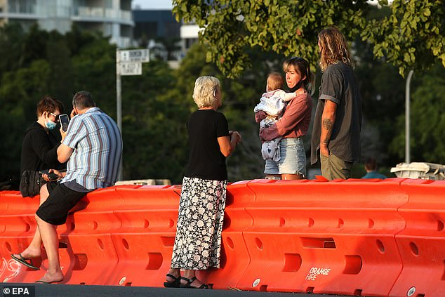 There are fears Western Australia and Queensland could cause a national recession by refusing to reopen their borders even as vaccination rates surpass 80 per cent (pictured are road blocks separating Coolangatta on the Gold Coast from Tweed Heads in New South Wales)