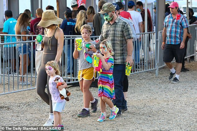 Tradition: The family could be seen walking past the rides at the traditional annual event which features live music acts, a carnival, food and drink, and a competitive chili cook-off