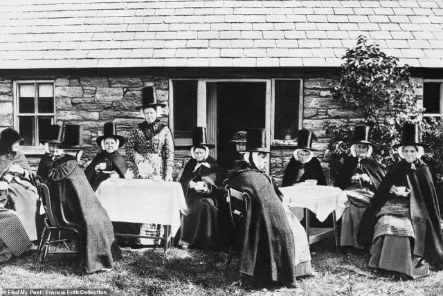Whilst the trove is only accessible to Findmypast members, users can search for place names to see how they looked when Queen Victoria was on the throne. Above: A tea party in Caernarfon, Wales, in 1900