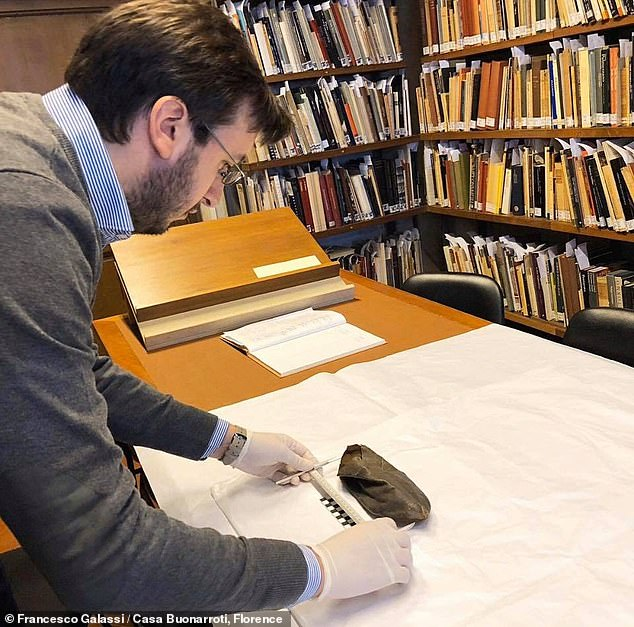 The study was undertaken by palaeopathologist Francesco Galassi and forensic anthropologist Elena Varotto of the FABAP research centre. Pictured: Professor Galassi takes a length measurement of one of the leather shoes in theCasa Buonarroti museum
