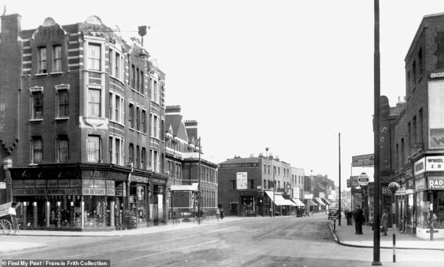 A near-deserted Peckham High Street is seen above in 1930. A few pedestrians and cars in the distance are the only signs of life