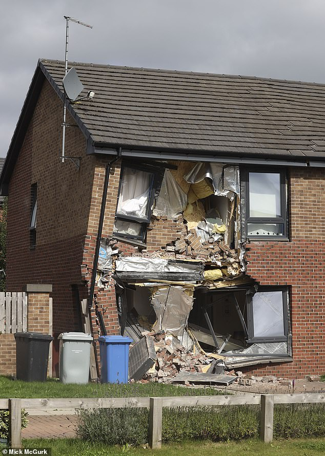 The front of the house was badly damaged with walls knocked out and windows smashed