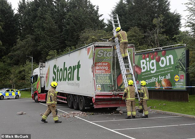 An Eddie Stobart lorry was later found abandoned in a nearby supermarket car park and cordoned off by police