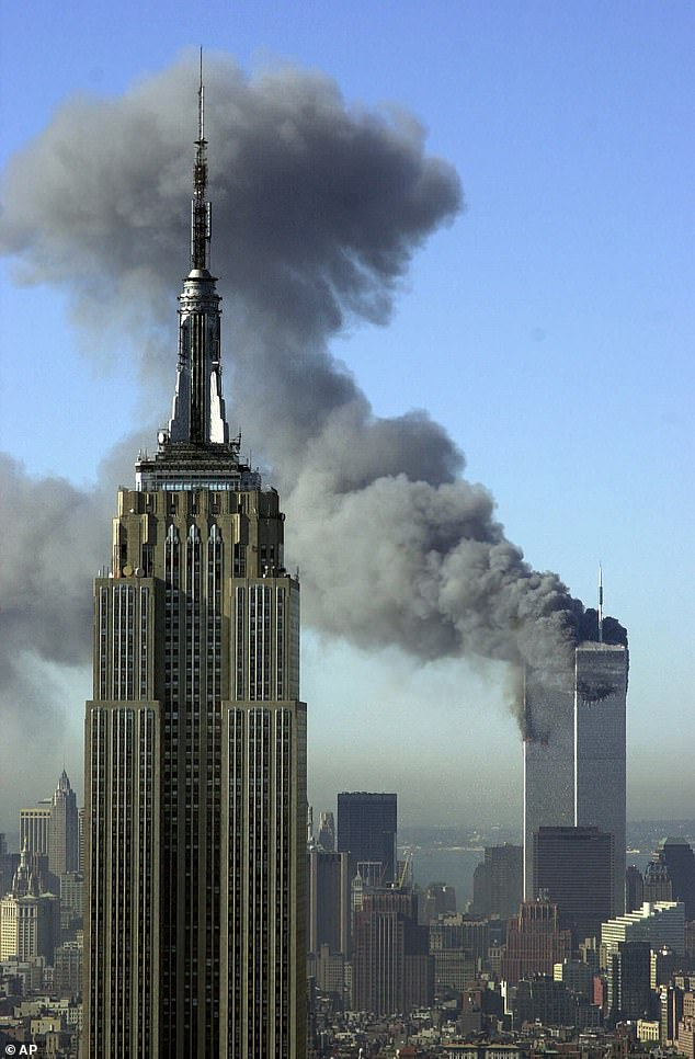Smoke billows out of the Twin Towers after terrorists flew two airplanes into the buildings on September 11 2001