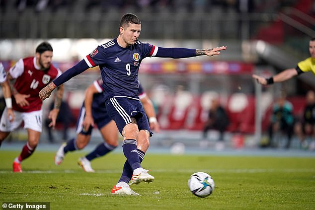 Dykes' spot kick was unerring and sent Scotland into second place in a closely-fought Group F