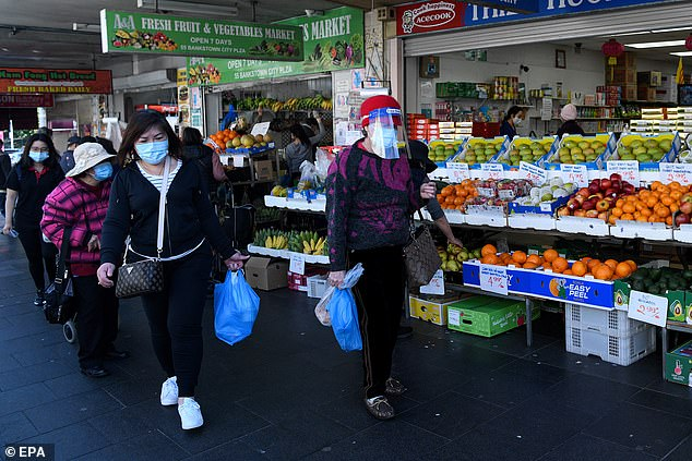 Residents wear face masks as they do essential food shopping in Bankstown on Wednesday