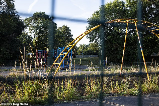 Pictures of the park show flaking paint and broken play apparatus with overgrown grass