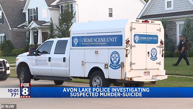 A crime scene unit vehicle is pictured outside the home where the bodies of the four victims were found on Tuesday afternoon