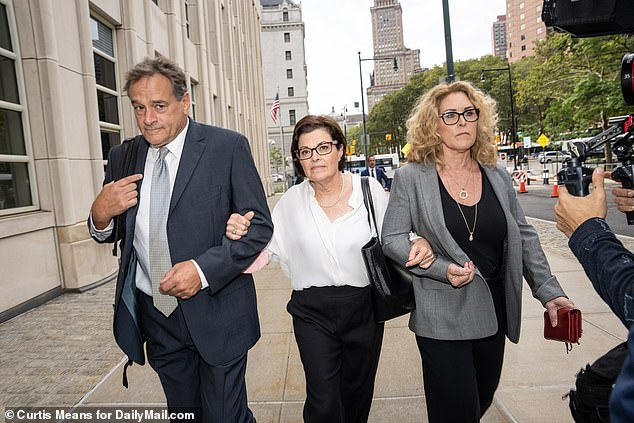 NXIVM cofounder and Keith Raniere's alleged 'second-in-command' Nancy Salzman (center) arriving at court Wednesday where she was sentenced to three and a half years