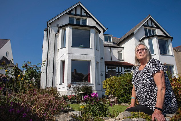 Ann Bedford (pictured) was left with nobody to care for those living at the Caledonia home in Holyhead, Anglesey, where 11 out of 12 of the residents were suffering from Covid-19