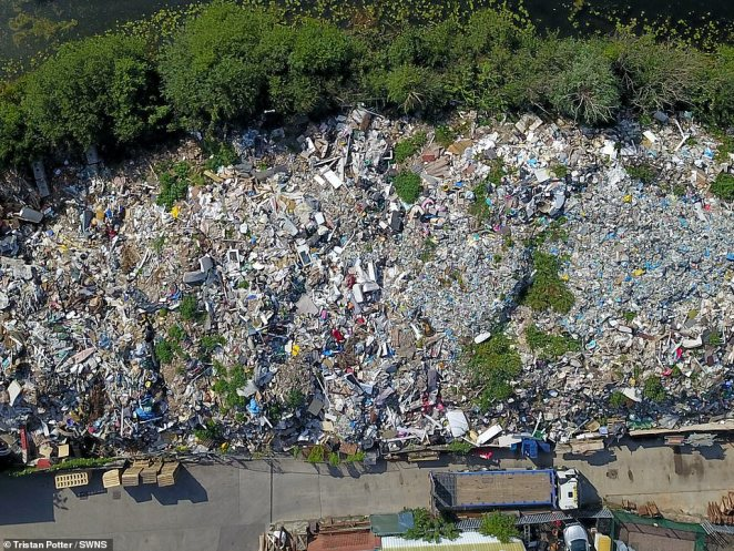 Furious residents have complained after a huge 32ft-tall mountain of rubbish piled up near their street, overlooking their homes and making their estate look like a 'Third World slum'