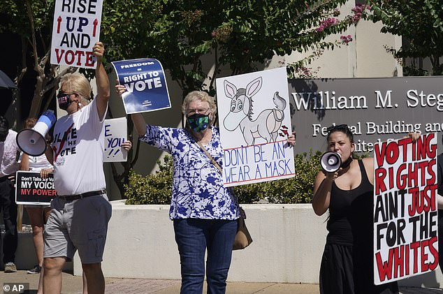 Protesters gather outside where Texas Gov Greg Abbott signed Senate Bill 1, also known as the election integrity bill, into law in Tyler, Texas, Tuesday, September 7