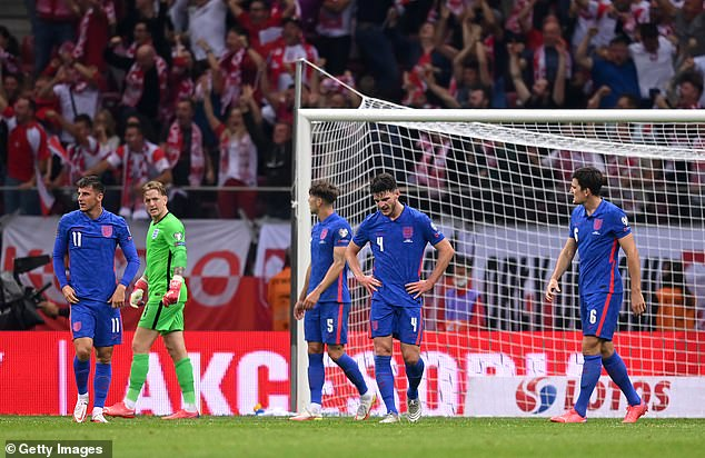 England players stand dejected after throwing away a stoppage time lead in Warsaw
