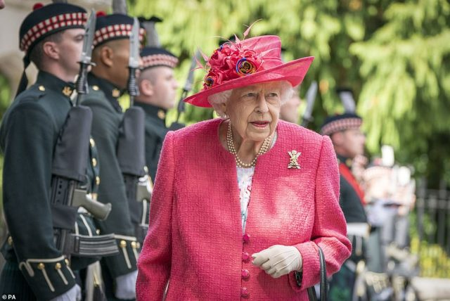 The Queen during an inspection at the gates at Balmoral as she takes up summer residence at the Scottish castle on August 9