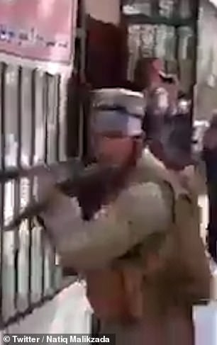 Armed Taliban fighters threatened protesters with weapons