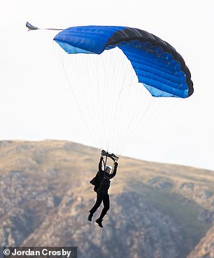 Safe and sound: His parachute opened seconds later